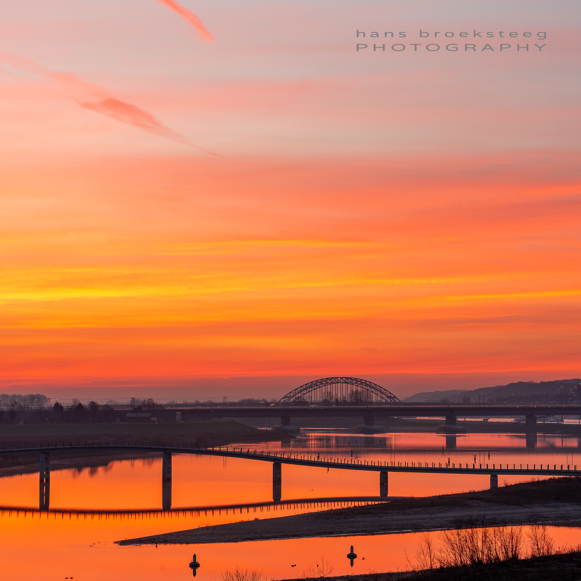 Morning view with amazing red sky over the Waal river, Nijmegen